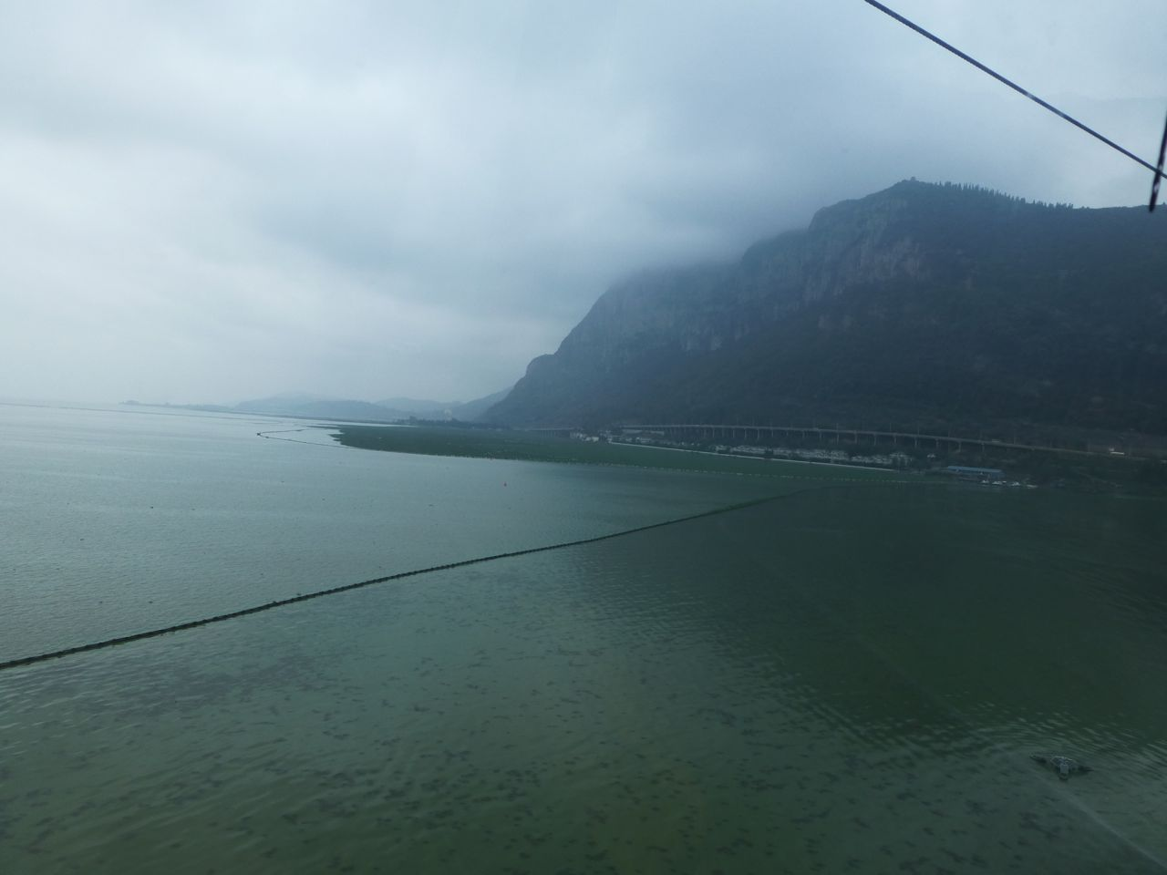 Crossing Dian Lake in a cable car