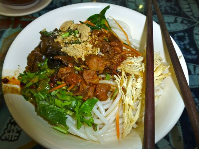 Rice noodles, mixian, are popular in many different forms, and is served hot, cold, with sauce and in soup. This is cold rice noodles with various vegtables and a little meat.